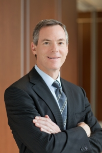 Formal headshot of Dr. Paul E. Jacobs, CEO & Chairman of the Board.